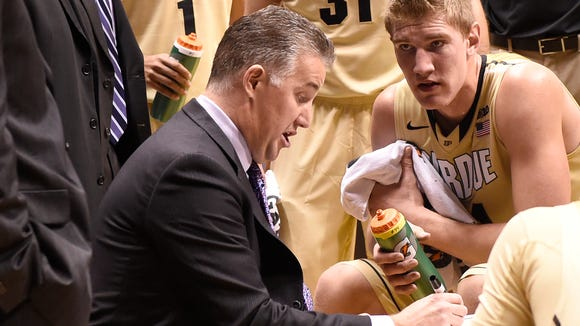 Purdue Boilermakers head coach Matt Painter draws up a play as center Isaac Haas (44) watches intently in the 2nd half against Grambling State at Mackey Arena. Purdue won the game 82-30.