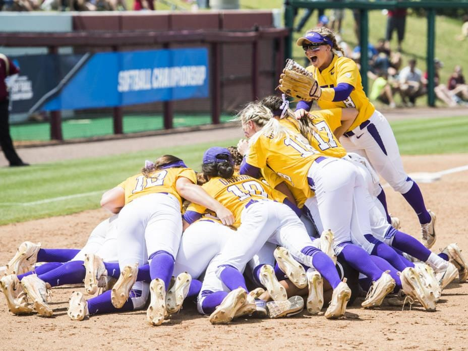 LSU players celebrate their win over Florida State to advance to the Women's College World Series.