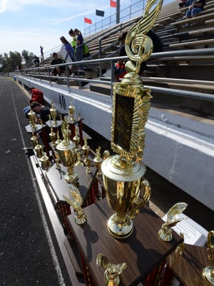 Trophies line a table for the winners of the Parkway Marching Band Competition Saturday afternoon at Elm Grove Middle School.