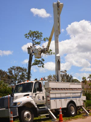 On tropical Trail at the Marsh Harbor neighborhood, neighbors constructed a stand out of 4x4's and 2x4's to raise up the power lines that were blocking the entrance to the neighborhood. FPL was repairing the line and transformer Tuesday afternoon. Recovery continued around Brevard County Tuesday as residents recover and clean up from Irma, many without power or water.