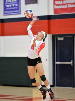 Pacelli senior Paige Hintz can hurt opponents in a variety of ways, including with a powerful serve.