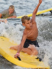 Hundreds of children ages 6-16 from beach patrols in Rehoboth Beach, Dewey Beach, Bethany Beach, Middlesex Beach, Delaware state parks,  Fenwick Island and Ocean City competed in events of running, swimming and paddleboarding at the annual Junior Lifeguard Olympics held in Rehoboth Beach on Tuesday, Aug. 8.