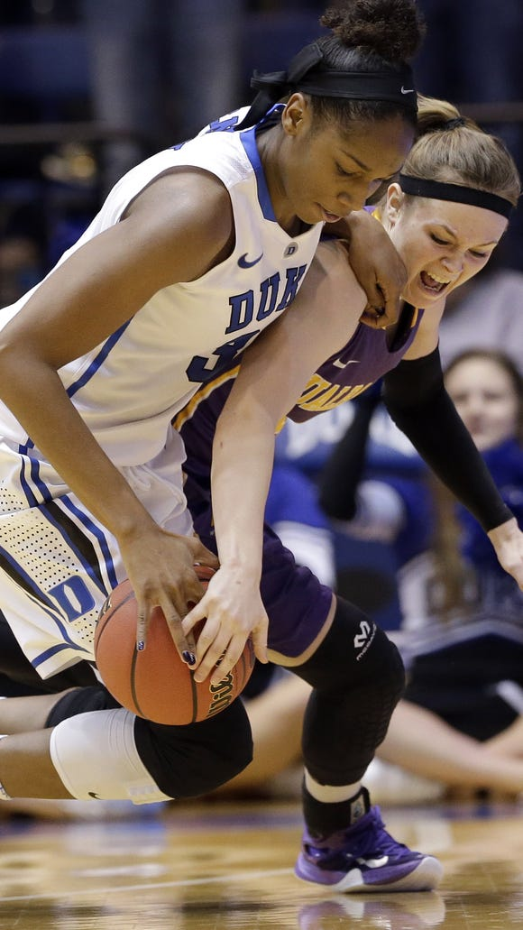 Duke's Amber Henson, left, and Albany's Sarah Royals battle for the ball during the second half of a women's college basketball game in the first round of the NCAA tournament in Durham, N.C., Friday, March 20, 2015. Duke won 54-52. (AP Photo/Gerry Broome)