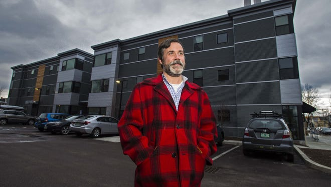 Developer Erik Hoekstra, seen in front of an apartment building on North Winooski Avenue in Burlington on Wednesday, February 17, 2016, claims that property tax assessments in the city are too high, which leads to higher rents.
