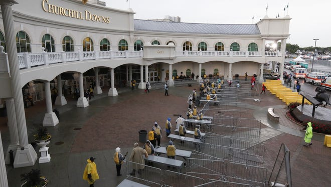 Rain depressed the number of people who showed up shortly after Gate 1 opened on Derby Day at Churchill Downs.  May 6, 2017