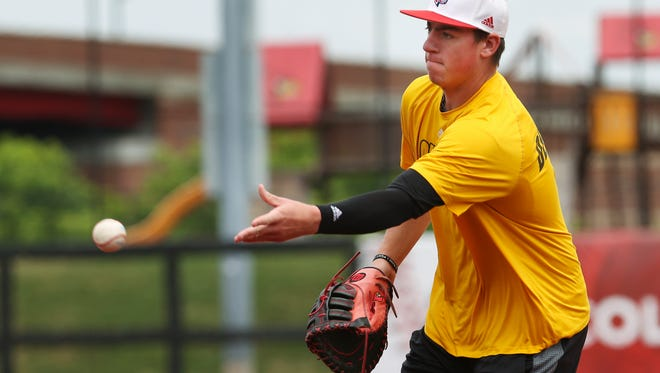 U of L's Brendan McKay (38) fields a ball during practice at Patterson Stadium ahead of the super regional baseball tournament.  June 8, 2017