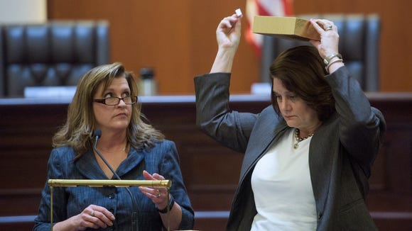 Beth Haisten, Confidential Assistant to the court, left, and Julia Weller, Clerk to the court, draw and read the names of judges in the Supreme Court Chamber in Montgomery, Ala., on Thursday October 27, 2016 as the lottery is held to pick the judges who will hear Roy Moore's appeal.