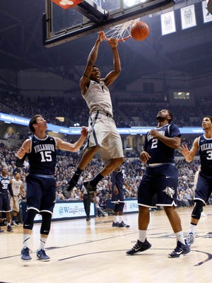 Xavier Musketeers forward Jalen Reynolds (1) dunks during the first half against Villanova Wildcats guard Ryan Arcidiacono (15) forward Kris Jenkins (2) and guard Josh Hart (3) at the Cintas Center.