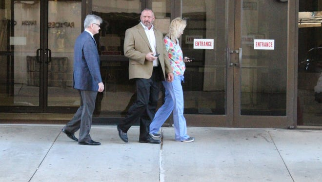 Stacy Lloyd Bender (center), a former Rapides Parish Sheriff's Office lieutenant who was fired after his July 2016 arrest, pleaded guilty on Monday to one count of malfeasance in office.