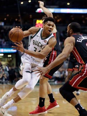 Bucks forward Giannis Antetokounmpo drives toward the basket.