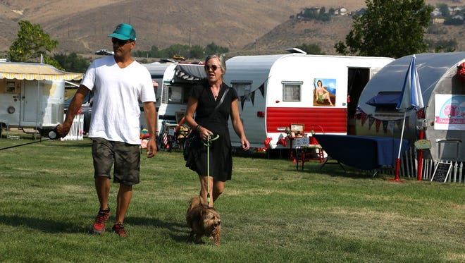 People take in the sights during the Hot August Nights Vintage Trailer Revival at Rancho San Rafael Regional Park in Reno on Aug. 9, 2018., 2018.