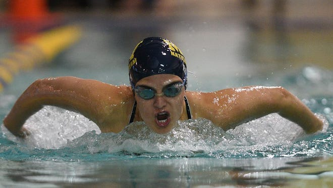 Richard A. Henson Family YMCA swimmer Megan Rush, who recently signed to swim for Butler University, practices her butterfly stroke.