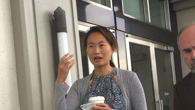 Shih Ya Hung, also known as Angie, leaves the District Court of Guam in Hagåtña on Oct. 17, 2017 with her attorney, Curtis Van de veld, right. Hung was sentenced to two years probation. She was caught unlawfully working in Guam while here on a tourist visa.