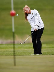 RBC's Amanda Hart chips onto the 17th green during