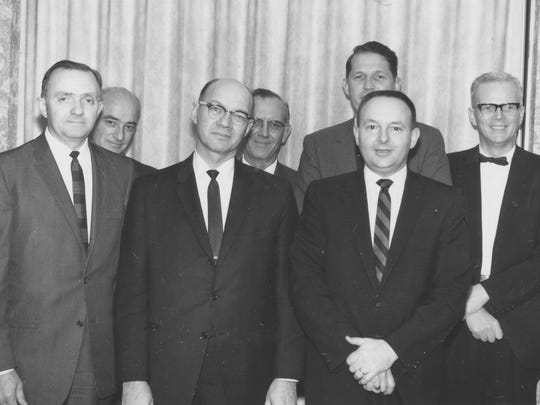 A photo of seven members of a Wisconsin team that died in the plane crash on March 23, 1967 in Vietnam. Front row (from left to right): Howard Johnshoy, Dean of Academic Affairs, Gustavus Adolphus College; A. Donald Beattie, Dean of the School of Business and Economics, WSU-Whitewater; Harry F. Bangsberg, President Bemidji State University; Back row: Vincent F. Conroy, Director of Field Studies, Harvard University; Melvin L. Wall, Head of Plant and Earth Sciences, WSU-River Falls; James H. Albertson, President WSU-Stevens Point; Arthur D. Pickett, Director of Honors Programs, University of Illinois-Chicago. Another team member, Robert La Follette, Agency for International Development official, is not pictured.