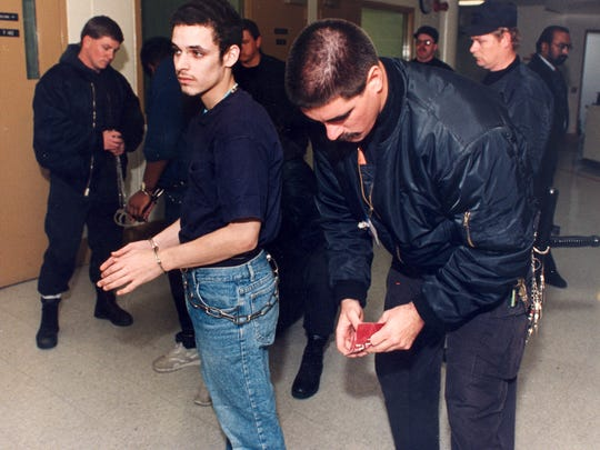 Donald Lee Torres is shackled by guards on Dec. 2, 1994, at Gander Hill prison prior to being moved to another facility.