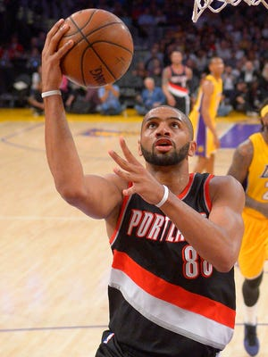 Portland Trail Blazers forward Nicolas Batum, left, looks to shoot against the Los Angeles Lakers on April 3, 2015, in Los Angeles.