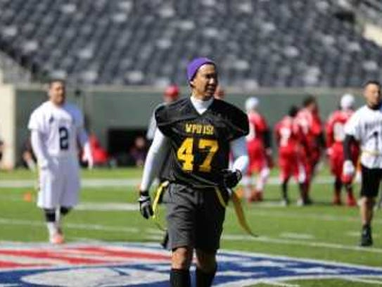 Clemente participating in a flag-football game at the 2014 New York Giants Snow Bowl for Special Olympics New Jersey at MetLife Stadium in East Rutherford.
