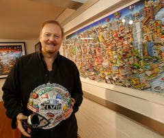 A Super Bowl helmet created by Charles Fazzino at his studio in New Rochelle on Dec. 30, 2013. Fazzino is the official artist for the Super Bowl.  ( Ricky Flores / The Journal News )