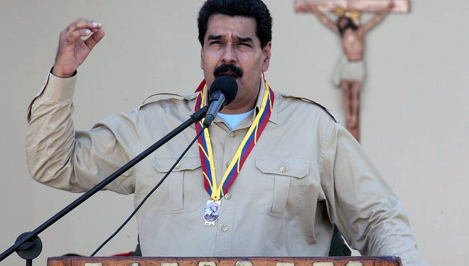 Venezuelan President Nicolas Maduro delivers a speech during a meeting with members of the national army in Falcon state, Venezuela on September 30, 2013. Maduro ordered the expulsion of the top US diplomat in Venezuela and two other embassy officials Monday, accusing them of plotting acts of sabotage with the opposition.  AFP  PHOTO/PRESIDENCIAHO/AFP/Getty Images ORIG FILE ID: 523396910