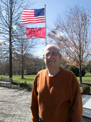 Donald Klieger, Manalapan,  has made it his mission to honor those Americans who made the supreme sacrifice. He wants to get the Killed in Action flag flying throughout New Jersey. Here he stands outside Manalapan town hall, where the KIA flag flies beneath the American flag.