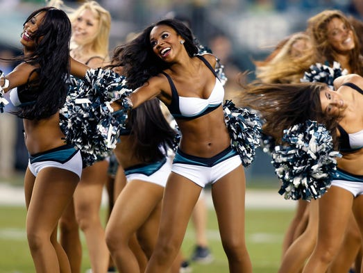 The Eagles cheerleaders take the field before the team in preseason action against Pittsburgh at Lincoln Financial Field in Philadelphia, Pa., Thursday, August 21, 2014.