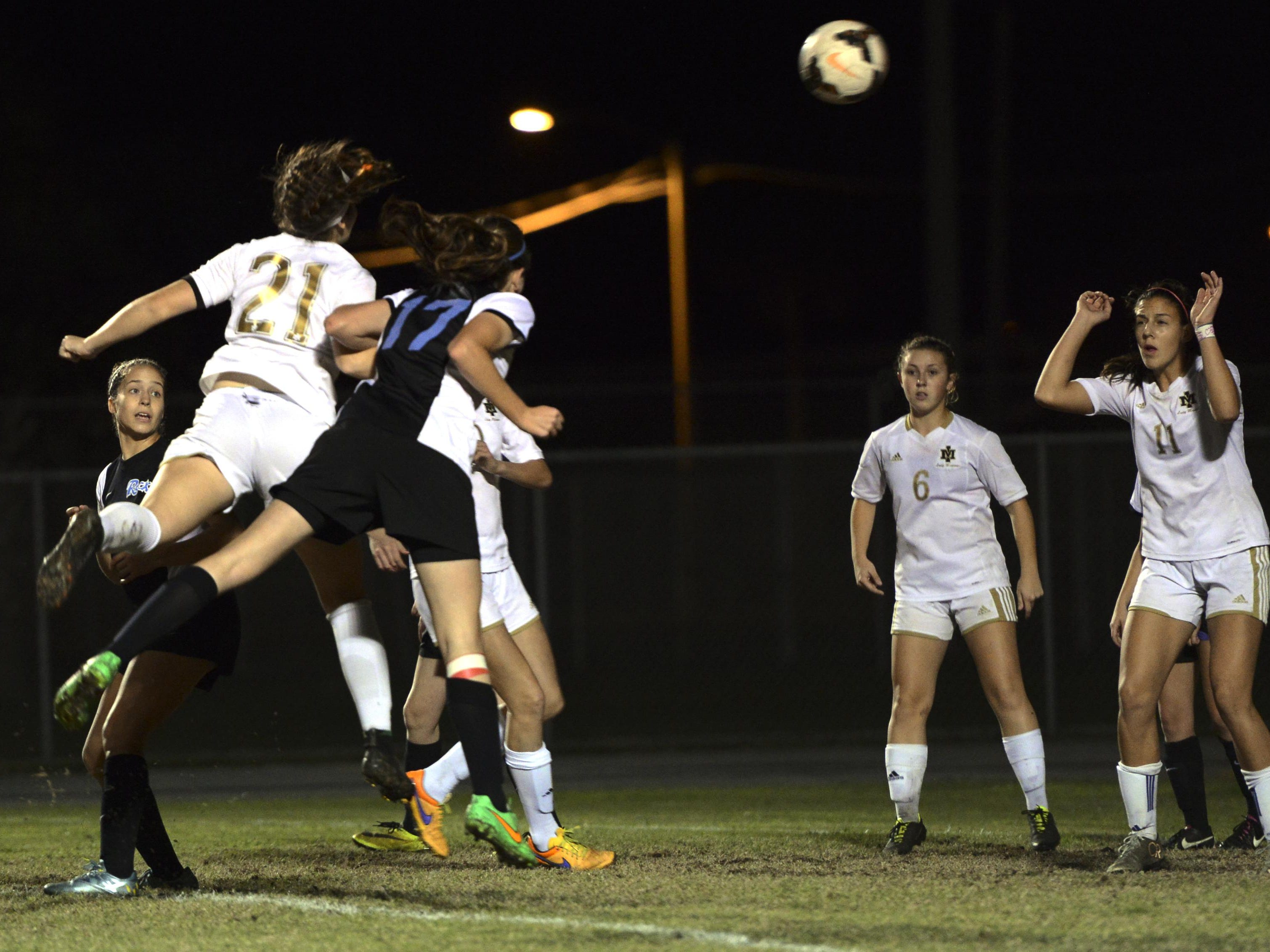 Merritt Island's Kaley Verpaele (21) scores on a header during Friday's district championship game against Rockledge.