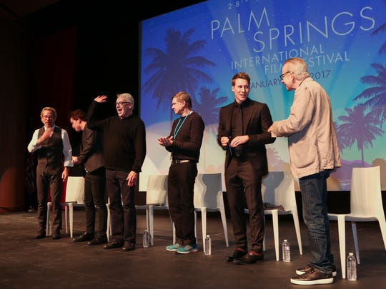 "Cleve Jones (third from left), who once lived in Palm Springs, waves to someone in the audience in January during the Palm Springs International Festival. Jones' memoir, ""When We Rise: My Life in the Movement,"" provided inspiration for the ""When We Rise""  miniseries that aired on ABC TV this year. It involved or involved (from left): actor Guy Pearce, actor Austin P. Mckenzie, Jones, director Gus Van Sant and Black. On the far right is Ken Jacobson of the festival."