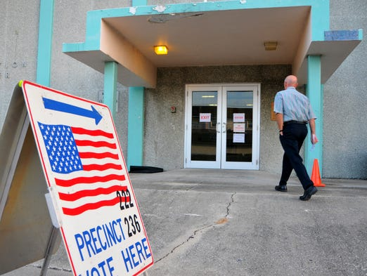 Tuesday is election day on the Space Coast for primary races. An early morning voter goes in the Ramp Road Recreation Complex in Cocoa Beach to cast his vote.