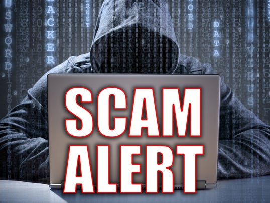 Computer hacker stealing data from a laptop