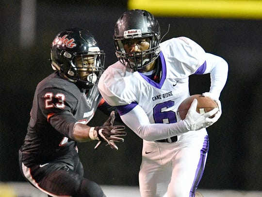 Cane Ridge's Jared McCray (6) moves the ball defended