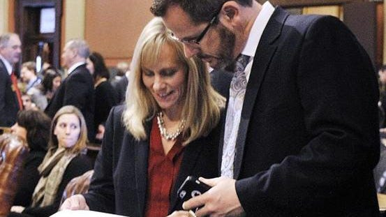 Rep. Cindy Gamrat, R-Plainwell, talks with Rep Todd Courser, R-Lapeer, on the first day of the Legislature's new session in January. The two lawmakers, in an unusual arrangement, combined their office operations, with three aides effectively working for both of them.