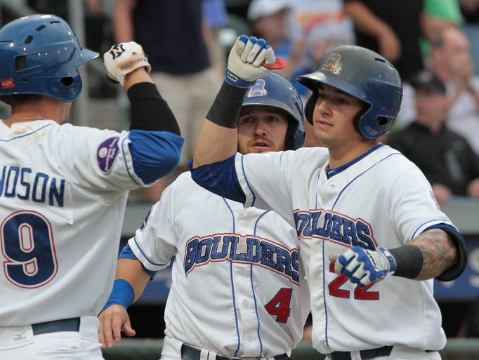 Rockland Boulders Joe Maloney celebrates with teammates Jerod Edmondson and Matt Nandin following a three run homer in the first inning against the New Jersey Jackals at Provident Bank Park in Ramapo Aug. 11, 2014.