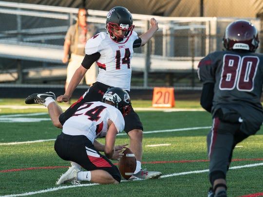 James M. Bennett kicker Steve Oscar (14) kicks a field