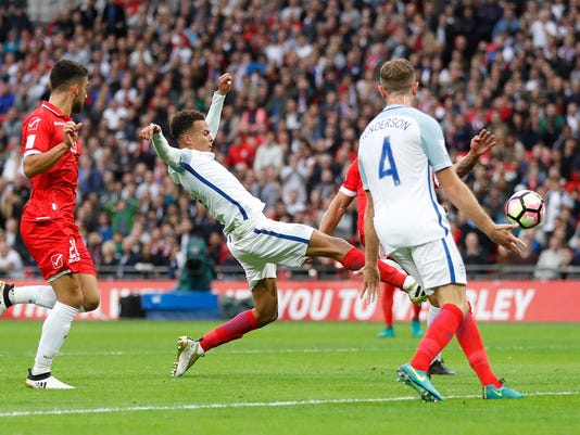 England's Dele Alli scores a goal during the World Cup Group F qualifying soccer match between England and Malta at Wembley stadium in London, Saturday, Oct. 8, 2016. (AP Photo/Kirsty Wigglesworth)
