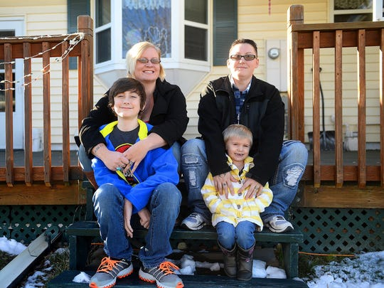 Noelle and Devon Lee with their children Xander and