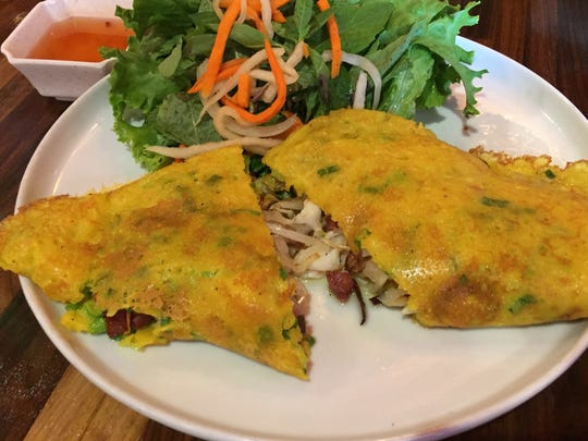 Banh xeo, the Vietnamese rice flour crȇpe, is stuffed at the new Creazian restaurant with pork belly and sweet-savory Vietnamese sausage.