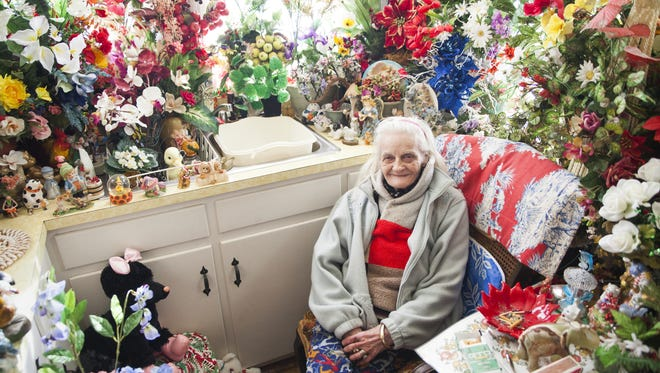 From 2015: With ice still melting on the streets outside, 86-year-old Myrtle Cason sits for a portrait inside her kitchen where artificial flowers give off a sense of spring's approach.