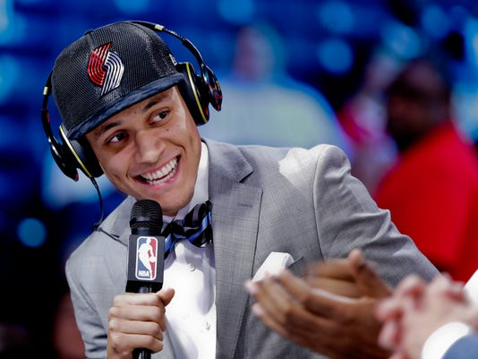 Justin Jackson answers questions during an interview after being selected by the Portland Trail Blazers as the 15th pick overall during the NBA basketball draft, Thursday, June 22, 2017, in New York. (AP Photo/Frank Franklin II)