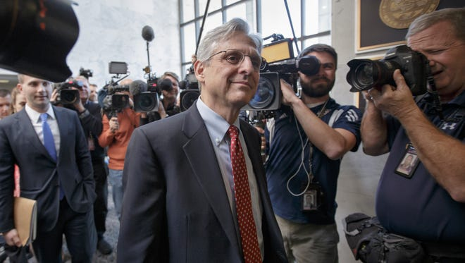 Judge Merrick Garland, President Barack Obama''s choice to replace the late Justice Antonin Scalia on the Supreme Court, arrives for a visit with Sen. Mark Kirk, R-Ill., the only Republican senator to meet the embattled nominee, on Tuesday.