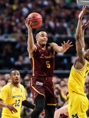 Loyola Chicago's Marques Townes goes for two but the