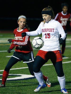 Fairport's Victoria Mayer takes control of the ball next to Penfield's Kinsey Uzalec in the first half at Pittsford Sutherland High School.