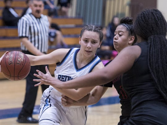 Redwood's Clarissa Chavez goes in for a layup against Hanford in a West Yosemite League girls basketball game on Tuesday, December 13, 2016.