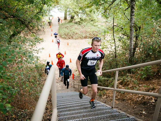 Participants in River 2 Ridge run up stairs after finishing the kayak portion of the event on Sunday, Sept. 17, 2017. Participants kayak the 6.2 miles from Salem's Riverfront Park to Spong's Landing in Keizer, and then bike 47.8 miles to Silver Falls, where they run a 5.8 mile loop of the state park. They can enter individually or as a relay team.