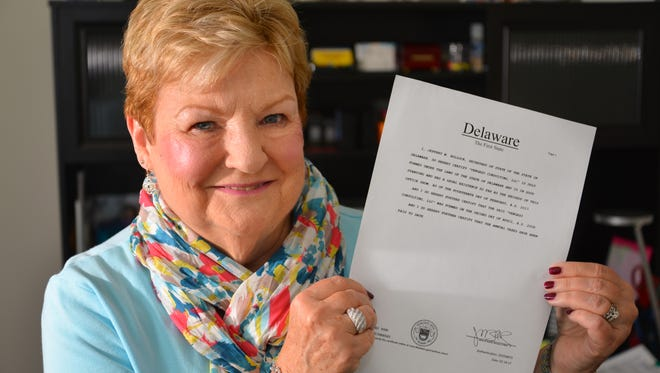 Kathy Vengazo, owner/president of Vengazo Consulting LLC displays her Certificate of Good Standing. Vengazo almost lost a contract because of Delaware's antiquated method of processing requests for the certificates.