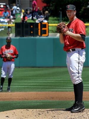 Indianapolis Indians pitcher Nick Kingham (50) has 13 seconds, according to the pitch clock, to pitch to Louisville Bats hitter during their game Sunday afternoon at Victory Field July 2, 2017.