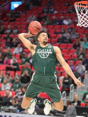 Michigan State forward Kenny Goins practices for the first round NCAA tournament game on Thursday at LCA.