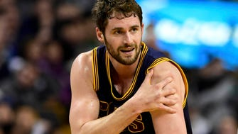 Apr 26, 2015; Boston, MA, USA; Cleveland Cavaliers forward Kevin Love (0) injures his shoulder during the first half in game four of the first round of the NBA Playoffs against the Boston Celtics. at TD Garden. Mandatory Credit: Bob DeChiara-USA TODAY Sports