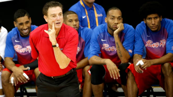 U of L coach Rick Pitino talks to his Puerto Rico team during the Tuesday's Pan Am Games opener.