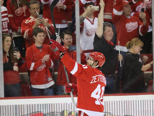 Red Wings captain Henrik Zetterberg celebrates the